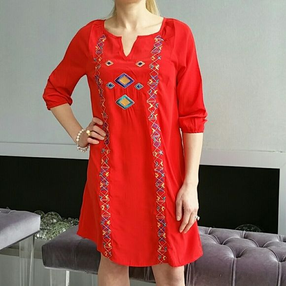 """Vibrant red Aztec print tunic dress NWT Brand new, tag attached  Gorgeous vibrant red tunic dress with Aztec threaded print on the front.  Size small Length approx 33"""" 3/4 sleeve with elastic at the ends Multi color print 100%polyester   ??Shop with confidence?? ????Suggested User???? 5?????????? star rated closet   Coachella, summer, spring, vacation, picnic, party, bohemian      Dresses"""