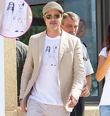 What a mighty special T-shirt! Brad Pitt arrived at the Marseille Provence Airport in Southern France wearing a sketch believed to be by his daughter, Vivienne.The drawing on the tee features daddy in his signature flat-cap holding mommy Angelina Jolie's hand!