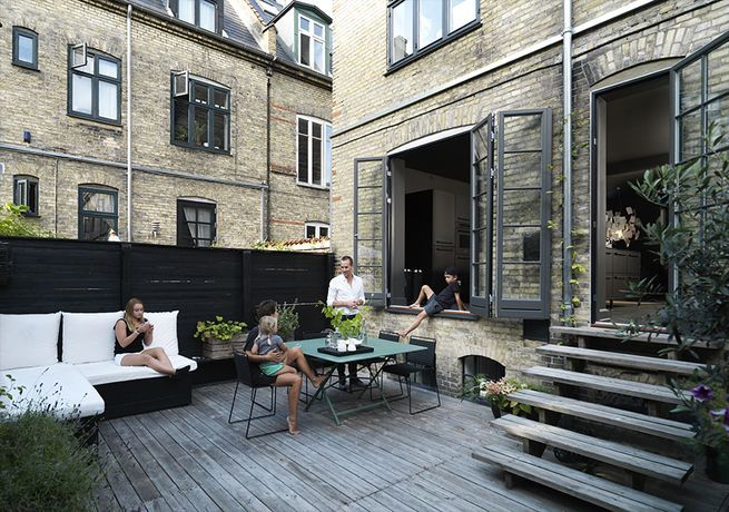 A 500-square-foot outdoor space with a grill, table, and hammock off a Copenhagen townhouse
