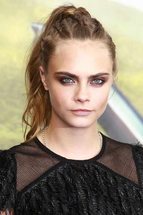 18 of the best unique bridal hairstyles: Up doesn't have to equal stodgy. Incorporate tightly woven braids or a metallic accessory to give a tail or twist an updated edge. Cara Delevingne