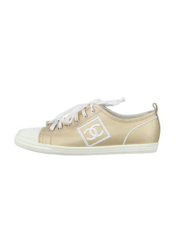 Gold steps with these Chanel Tennis Shoes.