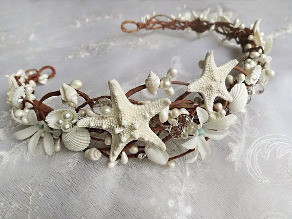 A magnificent starfish and seashell crown made of braided vines and embellished with various shells and flowers. Asymmetrically designed so that one