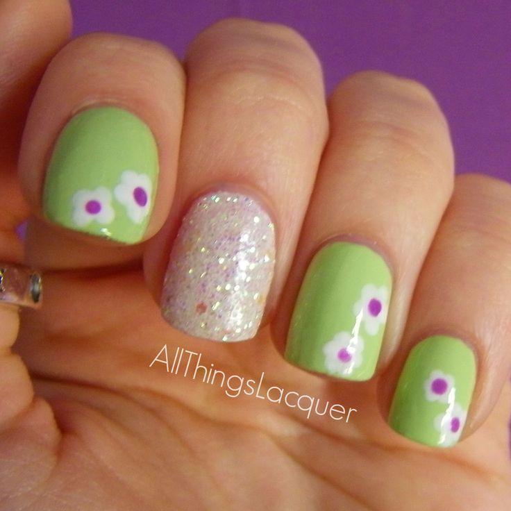 http://allthingslacquerr.blogspot.gr/2015/04/mint-glitter-flowers-mani.html
