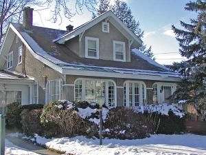 In the early 1900s, the American Craftsman home became popular throughout the U.S. Inspired by the Arts and Crafts movement in England and Scotland, imported craftsman handiwork and ideas are explored in this photo gallery.: Stucco-sided Bungalow