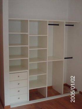Custom Closet - love the dual-height Clothes racks and drawers.
