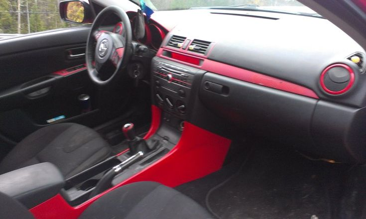My 07 Mazda 3 GT interior mods, Some is paint with clear and the other red carbon fiber wrap, Mazda logo cut to form the Evil-M logo throughout and some Mazdaspeed accessories throughout as well.