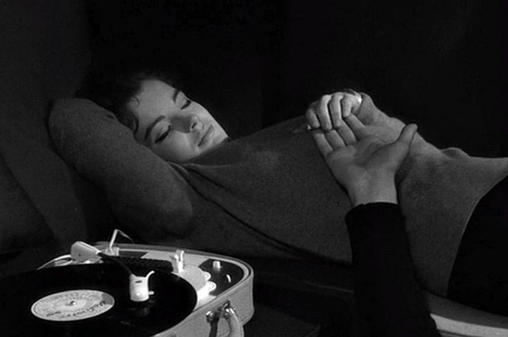 Romy Schneider (that is Henri Serre's arm) listening to a record in Le combat dans l'île (1962) directed by Alain Cavalier