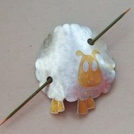 The one and only sheep shawl pin that I've made so far - Hilda!  Etched and painted pewter finished with a wooden pin