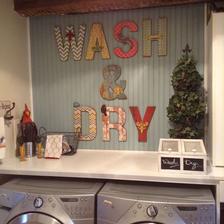 We gave our laundry area a little face lift. New shelf, bead board, paint and Alphabet soup letters from Michael's. I LOVE IT!!!