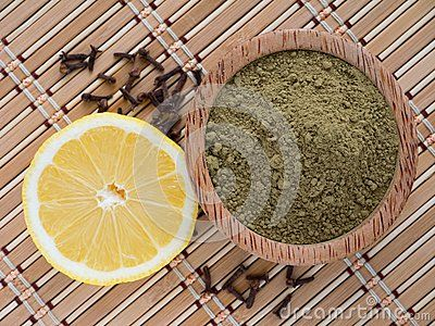 Henna powder and lemon on the bamboo mat
