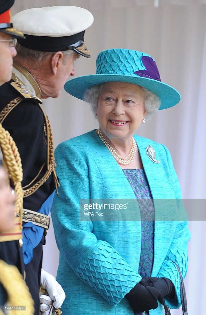 Queen Elizabeth II and Prince Philip, Duke of Edinburgh during an Armed Forces Parade and Muster in Windsor Castle on May 19, 2012 in Windsor, England. More than 2,500 troops, sailors, soldiers and Royal Air Force personnel from nearly all areas of the British Armed Forces were represented in the main body of the parade, together with a tri-Service Guard of Honour and six military bands. (Photo by Paul Vicente - WPA Pool /Getty Images)