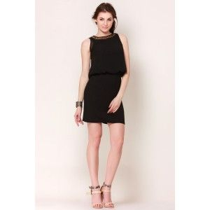 Black Sequins Blouson Dress The elasticized waist with over laying top adds a fashionable drama to your look. Pair the top with a cool pair of heels and your look will be complete for your party.