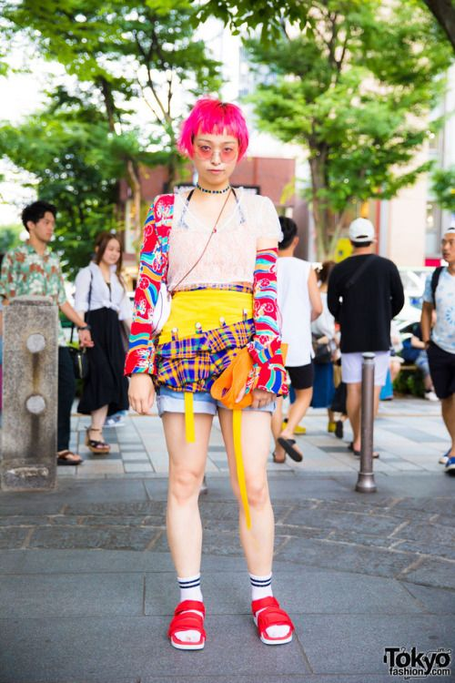 Remi on the street in Harajuku wearing a colorful look that was put together from mostly vintage and resale fashion along with a Bubbles Harajuku top and cute bag she won in a UFO Catcher. Full Look