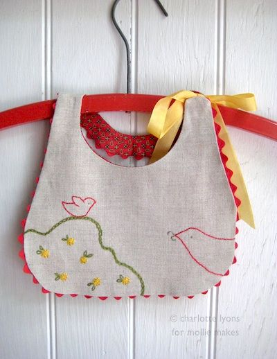 "sweet bib, cute birdie embroidery as in ""put a bird on it?"""