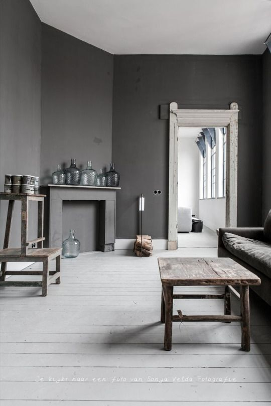 All Grey Room Its Rustic With Roughed Up Wood Furniture And Glass Water Jugs