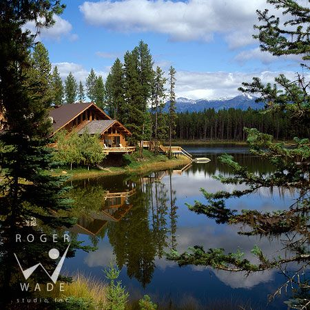 roger wade studio architectural photography of log cabin on an alpine lake in the woods looking out to mountain view, private ranch, swan valley, montana, by snow country construction