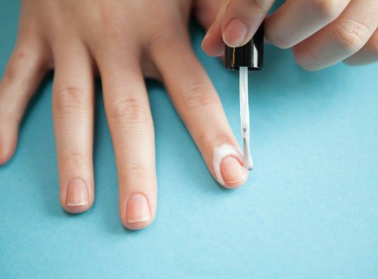 Line your nails with white craft glue before painting them for an easy clean up.