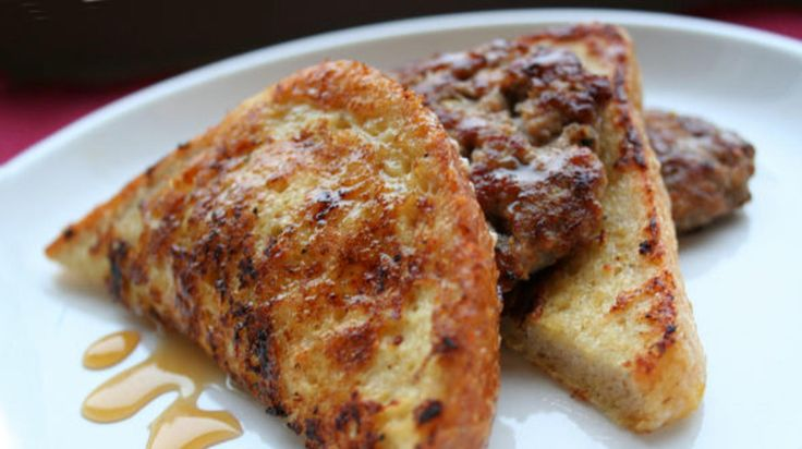 Black Pepper Parmesan Reggiano French Toast with Italian Sausage Patties and Warm Honey.