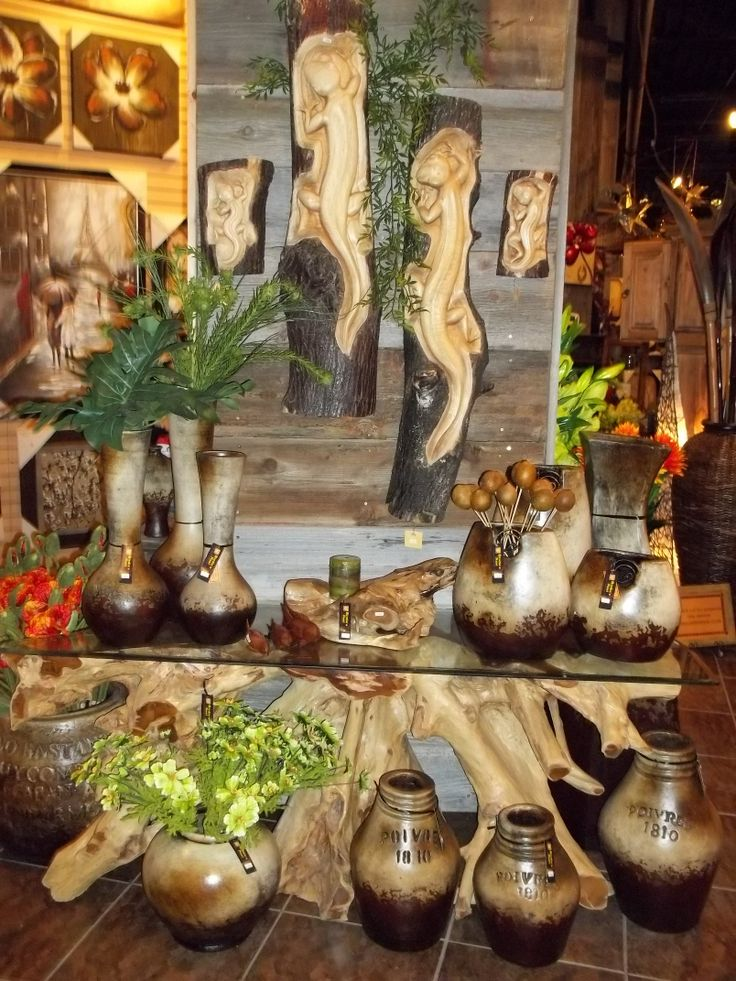 Natural teak root tables and log carvings!