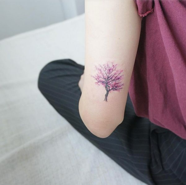 Tiny tree tattoo shows a passion for nature in a unique way. Image via @tattooist_flower