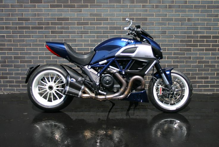 STILL AVAILABLE!! 2013 Ducati Diavel Blue Stripe ~ $16,995  One owner, Always serviced at Ducati Detroit (all service records), only 6200 miles Installed accessories include: Full Termi exhaust system with up-map Rizoma bar end mirrors and bar ends Rizoma adjustable billet levers Ducati Performance carbon fiber windscreen Custom diamond stitch matching alcantara seat Ducati Performance carbon fiber rear fender Rizoma billet reservoir covers