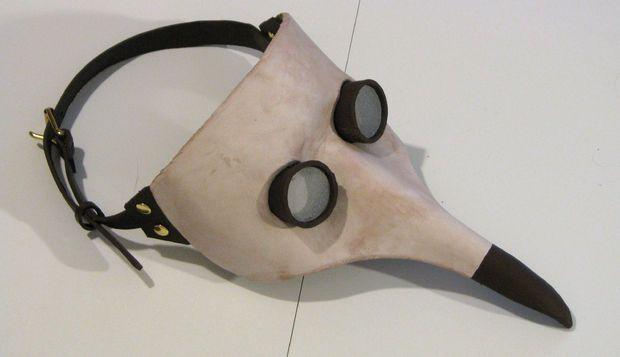 A creepy Hallloween mask, for sure!