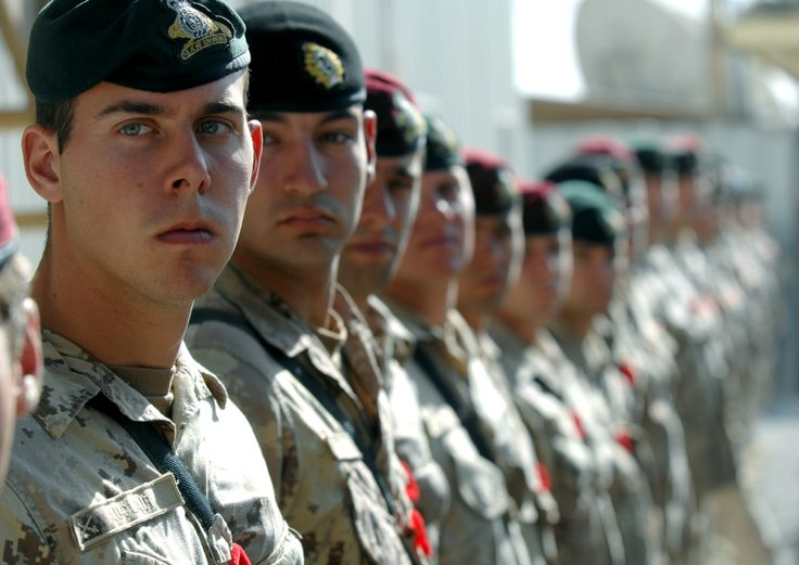 Canadian Forces soldiers from Joint Task Force Afghanistan Roto 4 line up to participate in a Remembrance Day ceremony held at Kandahar Airfield, November 11, 2007.     Photo by MCpl Robert Bottrill, Canadian Forces Combat Camera   #StrongProudReady