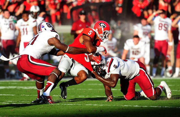 Terry Godwin #5 of the Georgia Bulldogs is tackled by Isaiah Johnson #21 and Jonathan Walton against South Carolina Gamecocks on September 19, 2015 in Atlanta, Georgia. Photo by Scott Cunningham/Getty Images) (Sept. 18, 2015 - Source: Scott Cunningham/Getty Images North America)