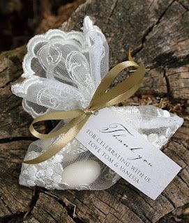 Jordan Almonds Wedding Favors: Jordan almonds wrapped in lace.
