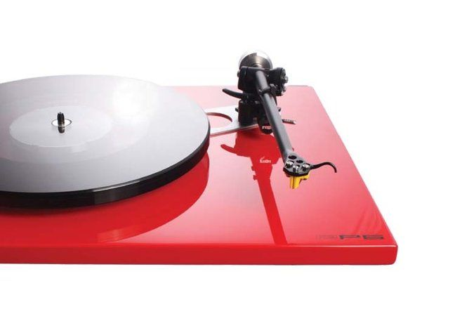"""Rega RP6   $1495–$1990 soundorg.com Rega's RP6 offers the same phenolic-resin """"double brace"""" found in the RP3, the same RB303 arm, and a whole lot more. Replacing Rega's traditional glass platter/felt mat is a two-piece, 16mm-thick flywheel/platter made of two joined pieces of float glass. Moreover, the RP6 comes standard with the TT PSU power supply. The large improvements in dynamic nuance and explosiveness, size and depth of stage. Reviewed with Exact 2 cartridge at $1990."""