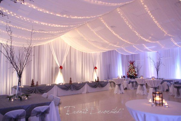 Events Decorated - Winter Wedding Reception.  Room draping, ceiling draping, twinkle lighting, up lighting, table linens, chair covers and sashes, floral centerpieces, and atmosphere decor.