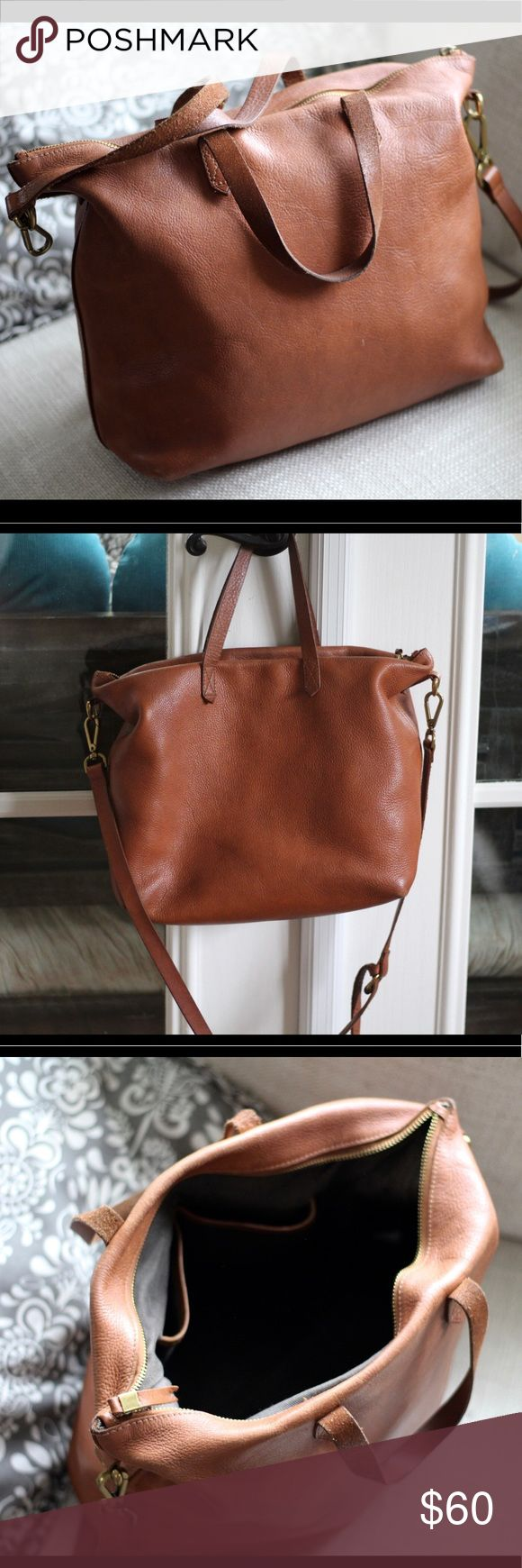 Madewell Zip Transport Tote This bag has signs of wears but still has tons of life left. Leather. Strap drop: 17.25. Handle:4 H:13 x L:15.75 x D:4.5. 3 pockets Madewell Bags Totes