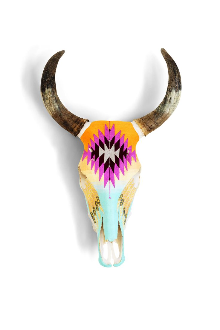 This cow skull is so cool. I love how it's decorated. It would look cool over a fireplace.