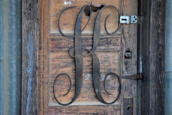 Voordeurhanger met letter van familienaam