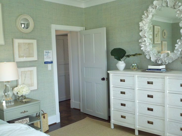 more beautiful beach house bedroom decor. Check out the mirror!
