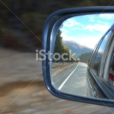 Looking Back in a Car Mirror Royalty Free Stock Photo