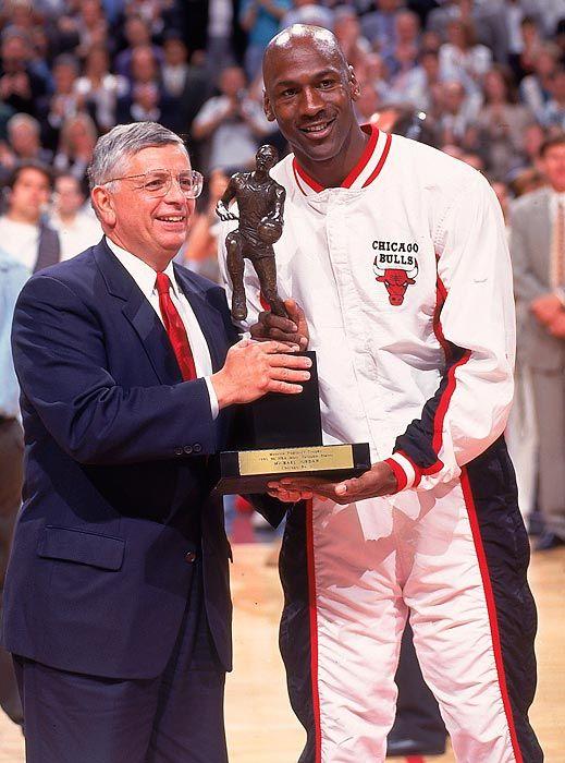 Michael Jordan receiving his fourth MVP award from David Stern