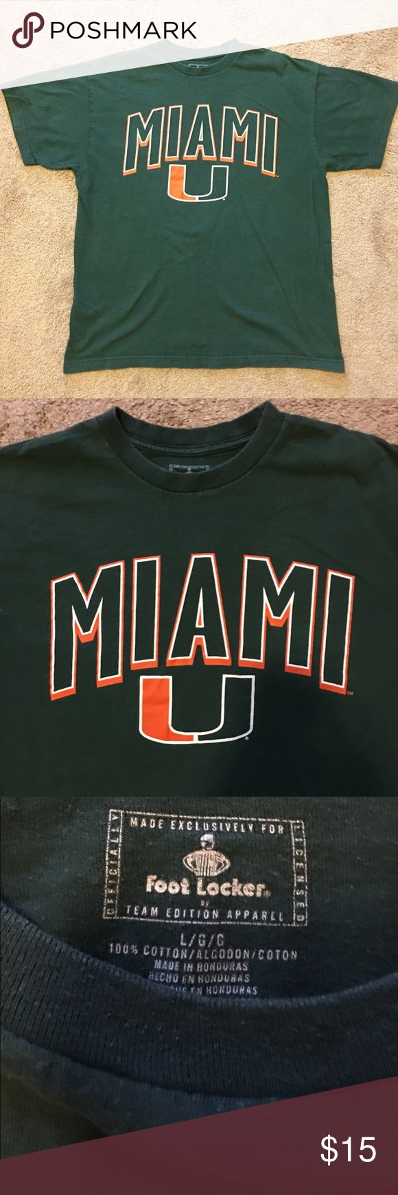 University of Miami College Shirt Very Nice Foot Locker Edition University Of Miami College T Shirt   Color is green with The Big U Logo On The Front Of The T Shirt  Size is Men's Large, In Great Condition Nike Shirts Tees - Short Sleeve