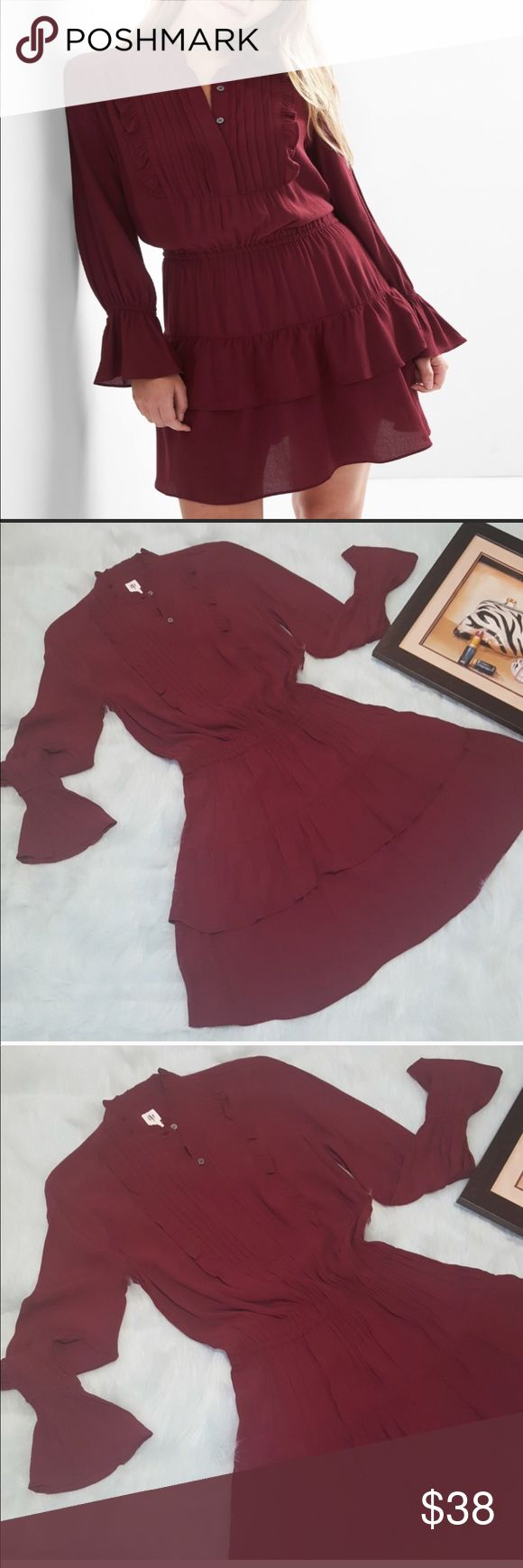Gap pin tuck dress🌺🌺New listing 💕 Gap ruffle pin tuck dress,straight silhouette with cinched waist ,cute long bell sleeve,ruffle crew neck.No trades or private offers must submit reasonable offer only 😊 GAP Dresses Long Sleeve