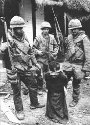 US Soldiers standing around Vietnamese civilian taunting him before shooting him