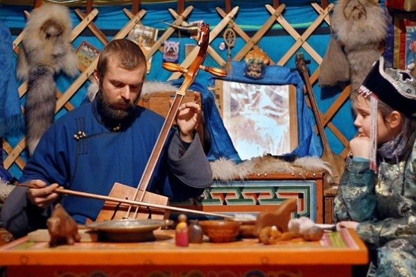Mongolian nomads live in their traditional way, welcoming guests with their music