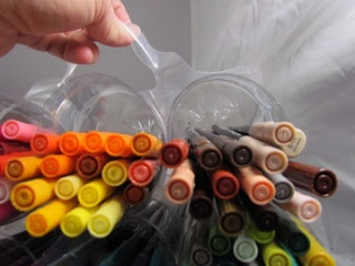 recycle bottle marker storage. this pin is amazing for up cycling ideas! good job creating it!!