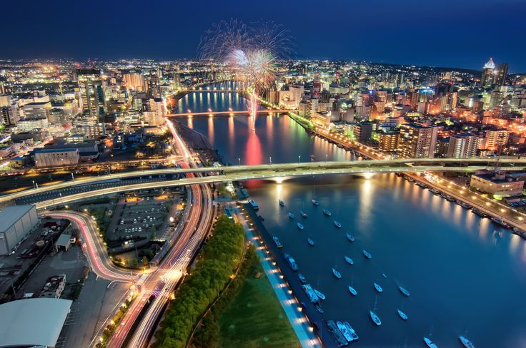 Shinano River, Niigata | Shinano River, Japan's longest river flows through Niigata City and into the Sea of Japan. On a clear day Sado Island can be seen in the distance.                                                                          The fireworks were a 90 second celebration for a wedding party.