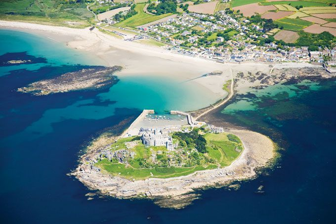Marooned off Marazion on the Cornish coast,  St Michael's Mount is home to Lord St Levan. The abbey on top of the mount is steeped in history, while the subtropical gardens are best viewed from above.
