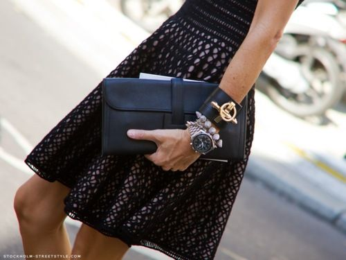 love the feminine black lace dress w/the 'tough' oversized jewelry...big, oversized watches still on trend...