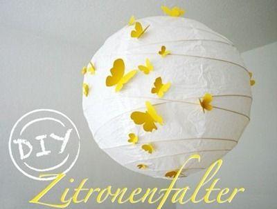 lampara de papel con mariposas amarillas Lámpara de papel con mariposas amarillas