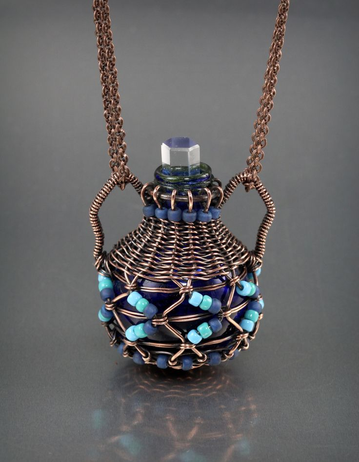 """""""I found a little bottle at the bead show and thought I'd try and weave a little basket around it. I watched basket weaving tutorials to figure out how to do it."""" -- by Lisa Barth"""