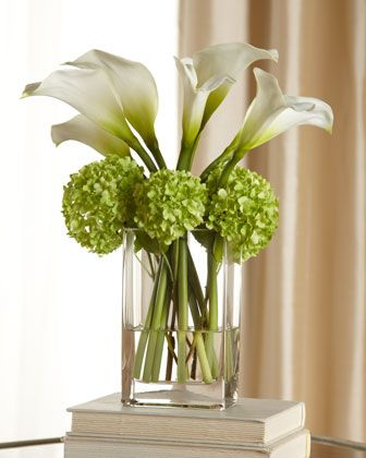 I like this arrangement!  Don't know how I feel about the green hydrangeas, but it looks cool.