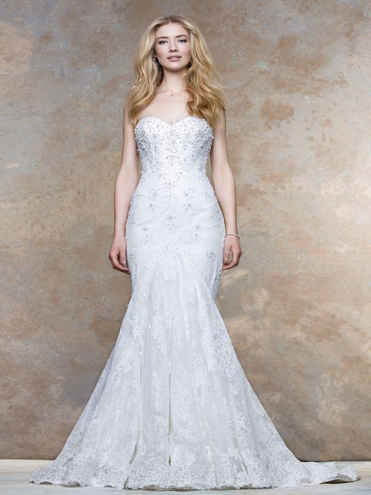 Poppy. Delicately re-embroidered lace sweetheart neckline with jewel encrusted floral appliques, covered buttons down to the train and full scalloped hem. Crafted in tulle, lace and horse hair with beaded appliqué, Buttoned back flowing down the train. Interest Free Payment Plan Available. #prudencegowns #Ellis #DressingYourDreams #Plymouth #Devon #Cornwall #Exeter #bride #weddingdress