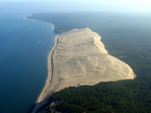 Dune of Pilat, France. The Dune of Pilat, also called Grande Dune du Pilat is the tallest sand dune in Europe. It is located in La Teste-de-Buch in the Arcachon Bay area, France, 60 km from Bordeaux. The dune has a volume of about 60,000,000 m³, measuring around 500 m wide from east to west and 2.7 km in length from north to south. Its height is currently 110 meters above sea level. The dune is a famous tourist destination with more than one million visitors per year. #france #travel…